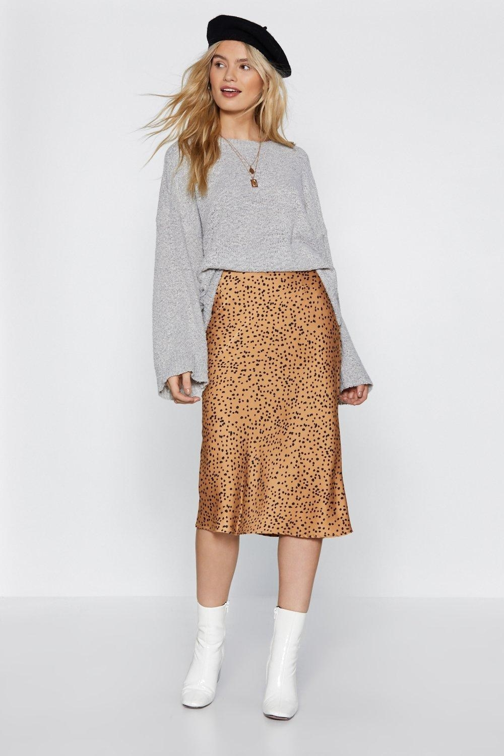 Model in the tan and black spotted skirt