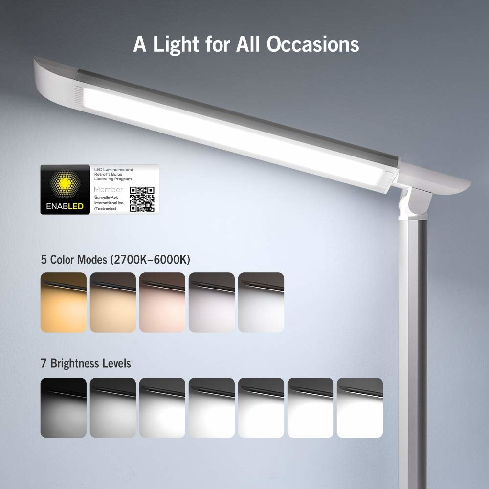 The lamp, which looks like a long rectangle on a stand, plus samples of each of its warm to cool color modes, and seven brightness levels