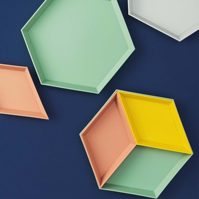 Geometric trays in pink, yellow, green, and white