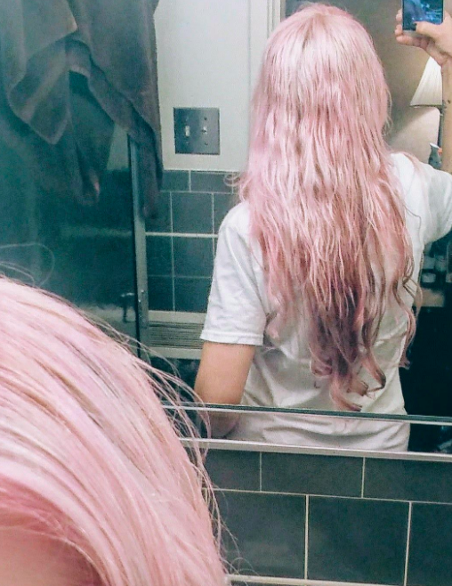 reviewer with pink hair