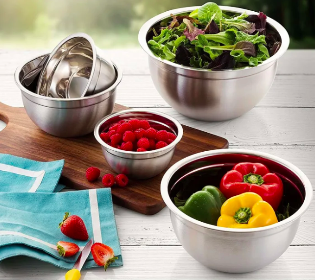 The four mixing bowls filled with fruits and veggies