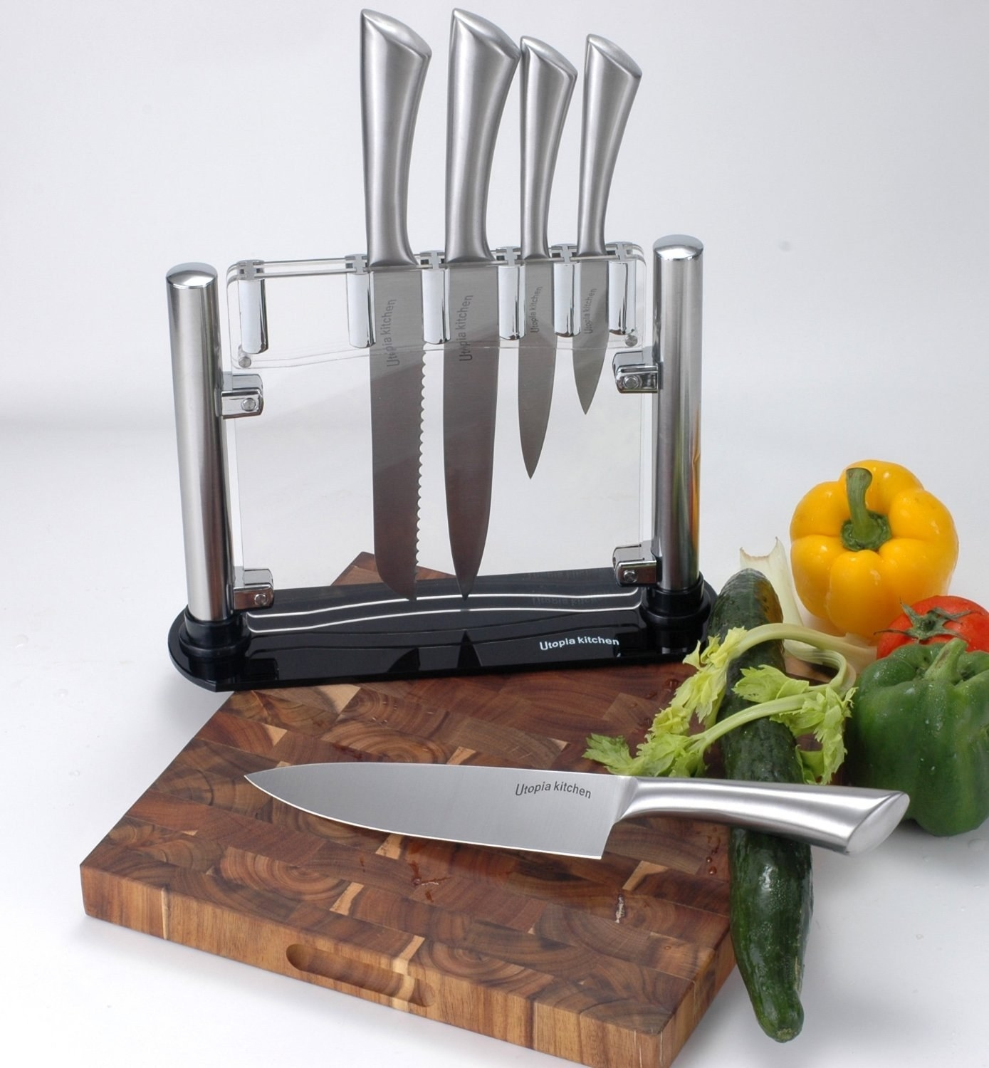 Clear knife block with five silver knives