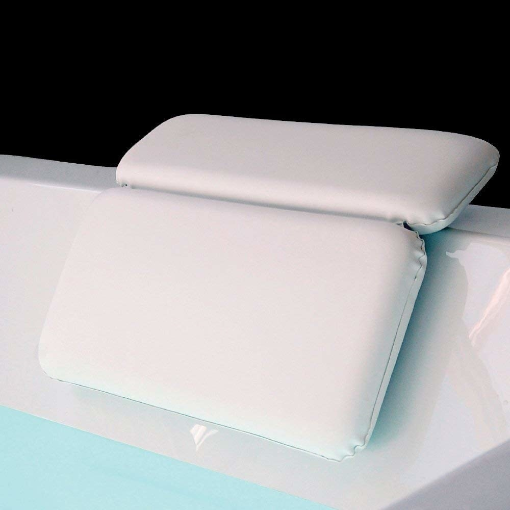 cushioned pillow hanging over side of tub