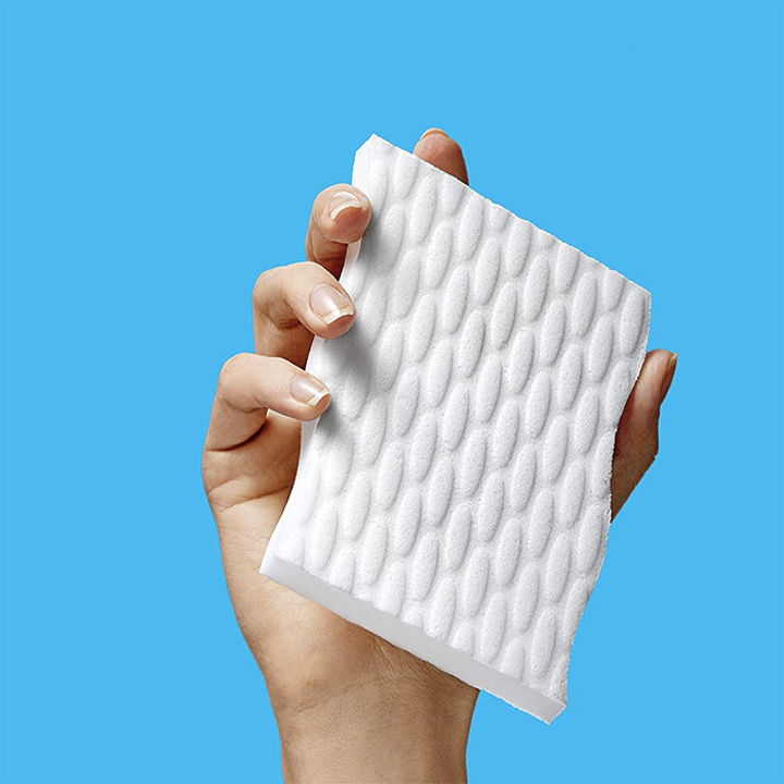 hand holds white square sponge