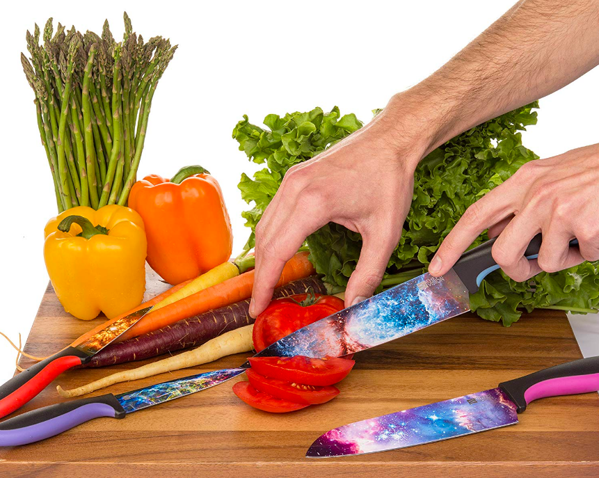 Kitchen knives of varying styles and sizes, all with galaxy prints on the blades