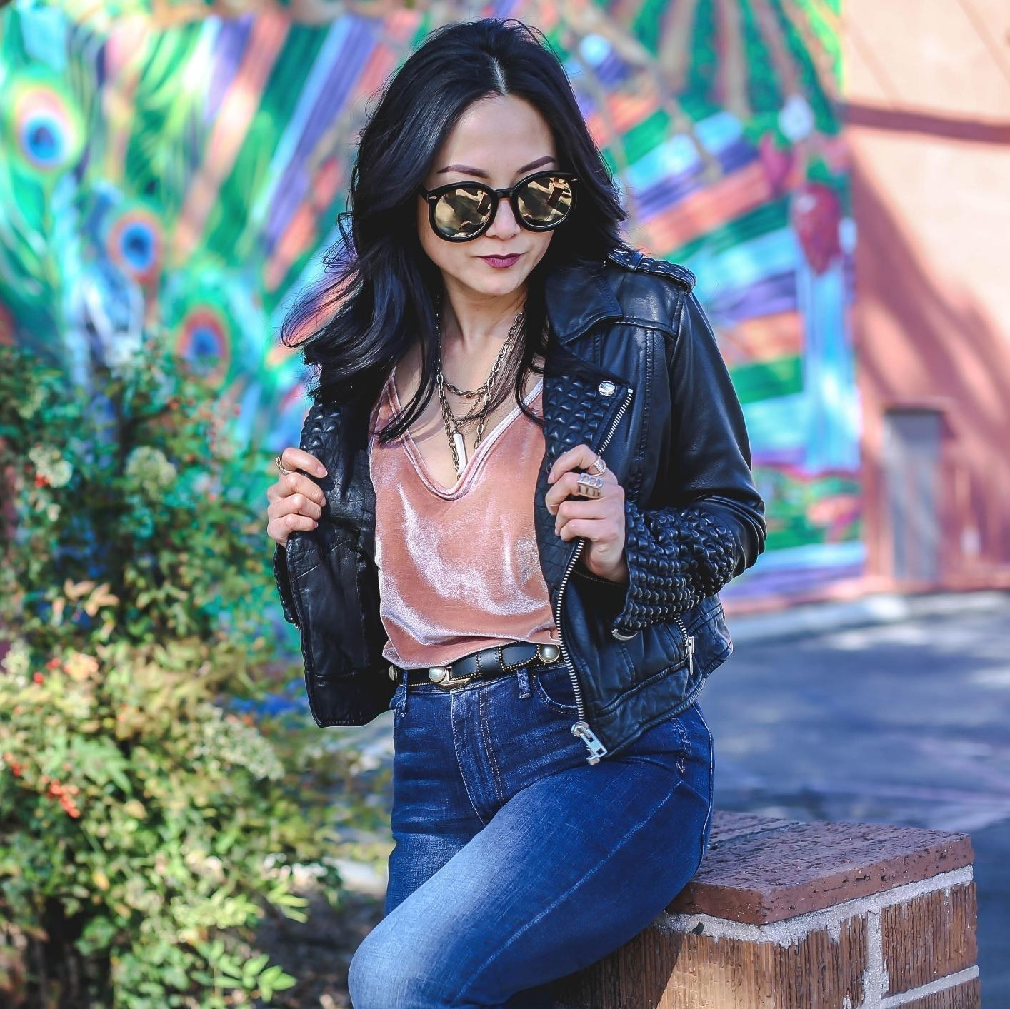Reviewer in the pink cami with jeans and a leather jacket
