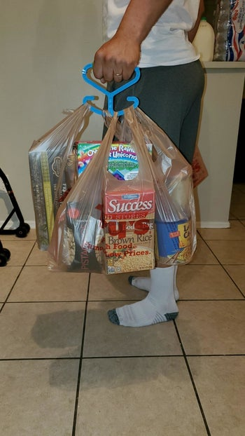 Reviewer photo using the handle to hold three grocery bags full of stuff