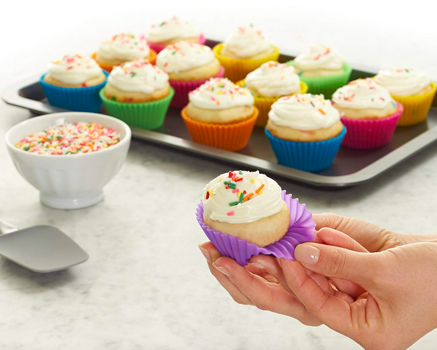 Person peeling back cupcake cover showing flexibility and reusability