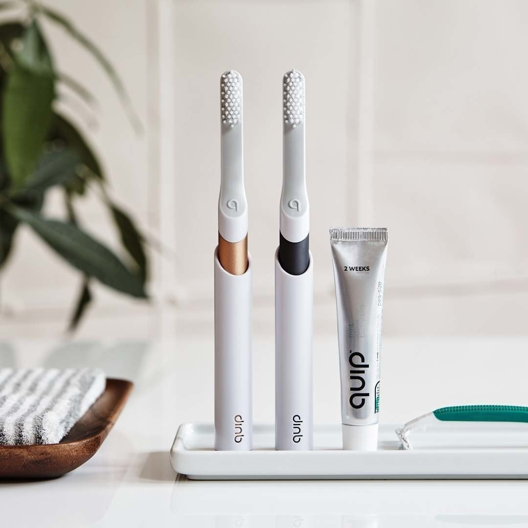 The toothbrushes in matte gold and black