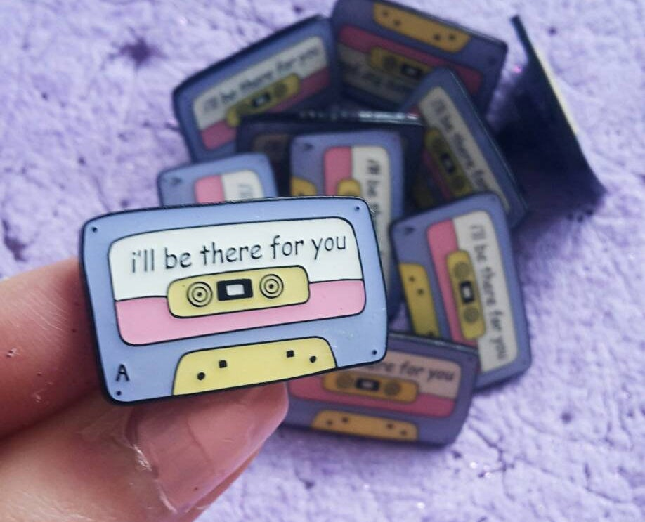 a casette tape pin that says i'll be there for you on it
