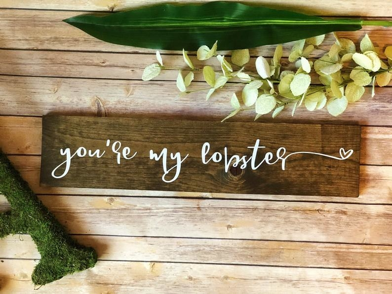 a wooden sign that says you're my lobster on it