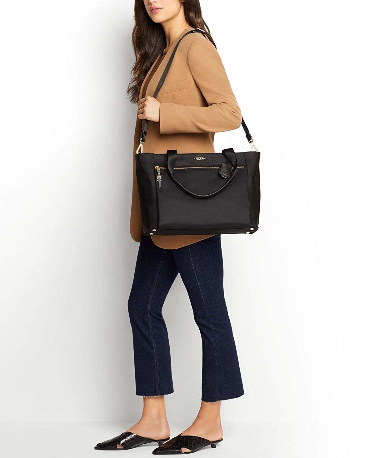 Model carrying the tote in black over their shoulder