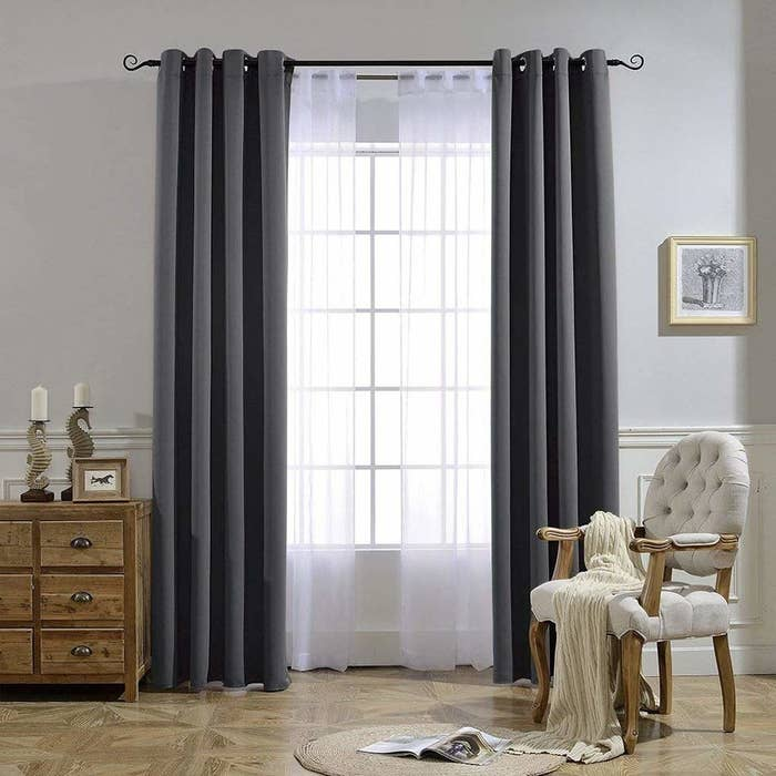 the blackout curtains in gray over a window