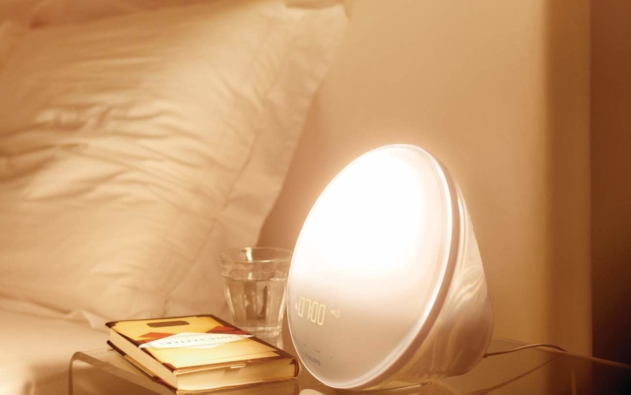 A wake-up light turning on by bed