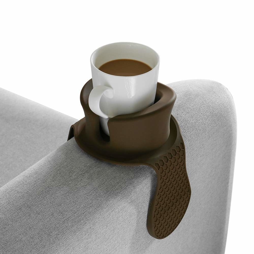 the weighted drink holder holding a cup of coffee