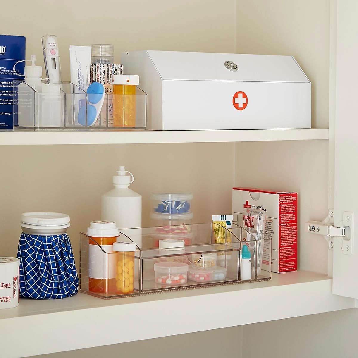 open view of a medicine cabinet with a lockable medicine storage box