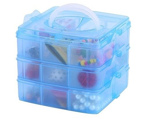 the three tier plastic organizer with small compartments in it