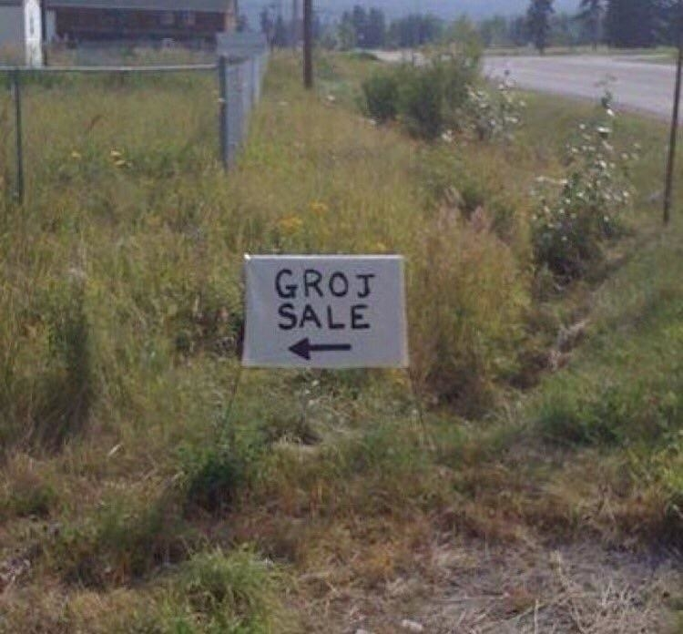 "Sign reading ""groj sale"""