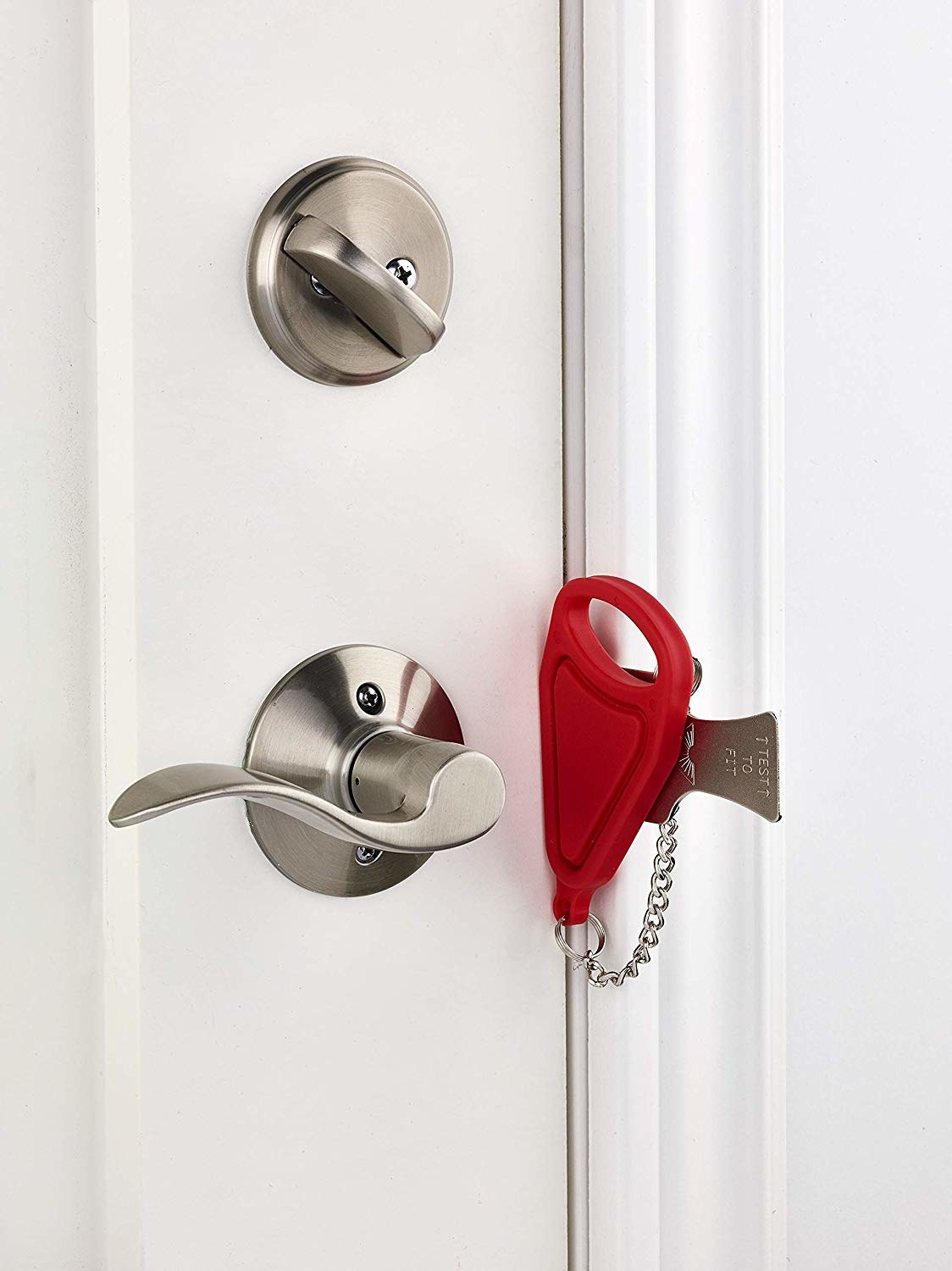 Thin red lock and metal addition slid into doorframe