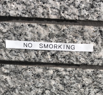 "Sign reading ""no smorking"""