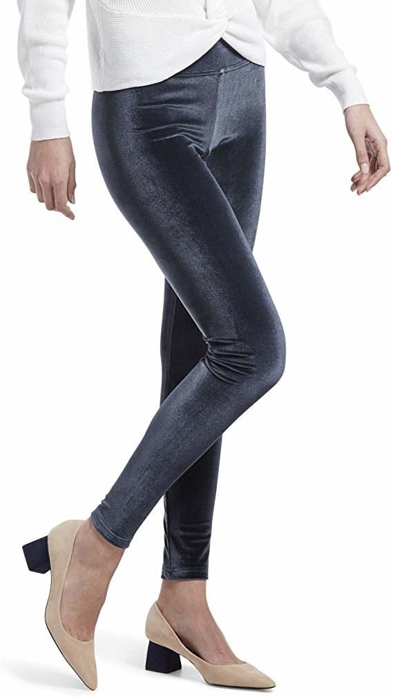 model wearing dark gray velvet leggings with heels
