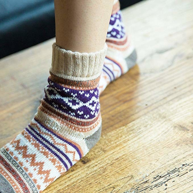 person wearing colorful argyle print socks