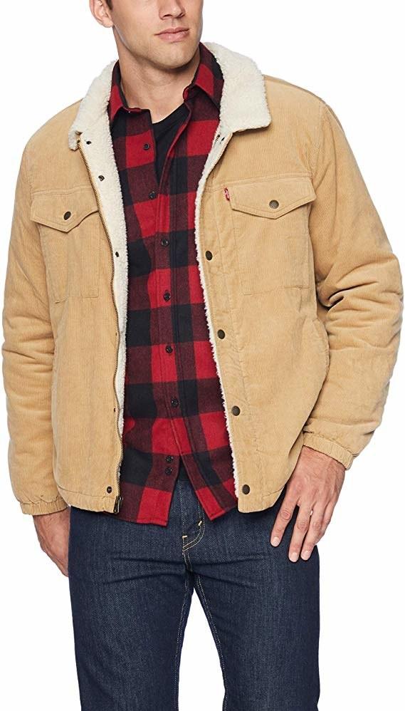 model wearing the light beige sherpa-lined collared trucker jacket
