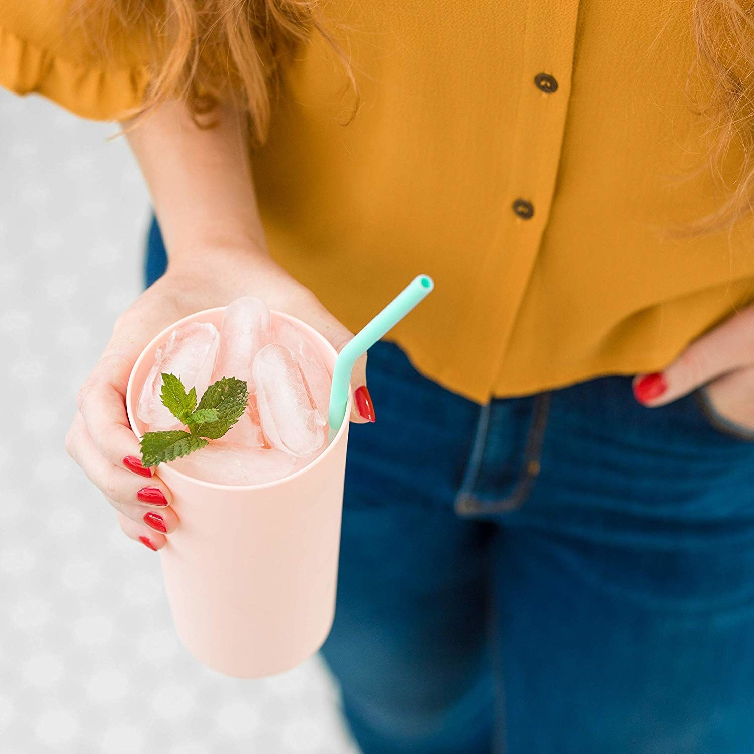 cup with reusable straw in it