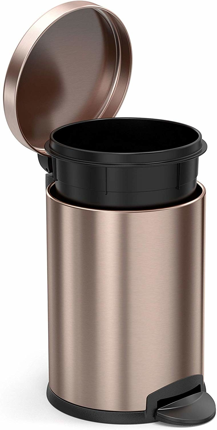 small cylinder copper color trash can with step pedal to open