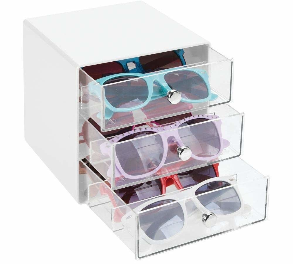 organizer with clear drawers containing glasses