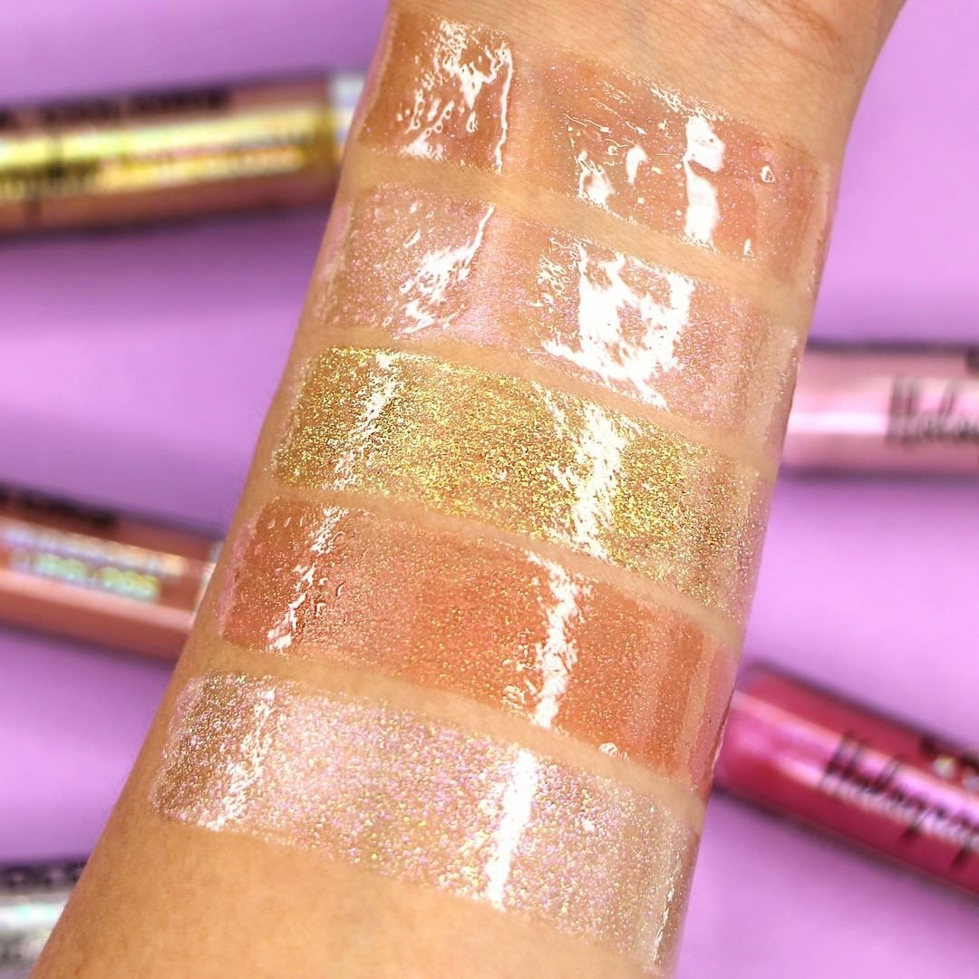 Picture of model's arm with five swatches of the high-shine gloss