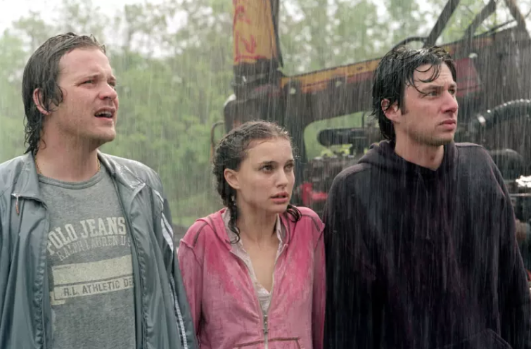 Scene from Garden State with Andrew, Sam, and Mark standing in the rain