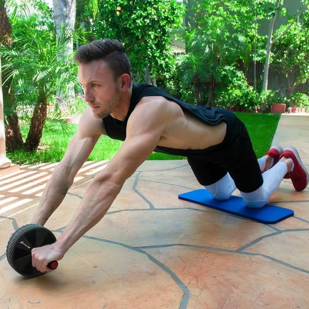 Person exercising while using the knee pad