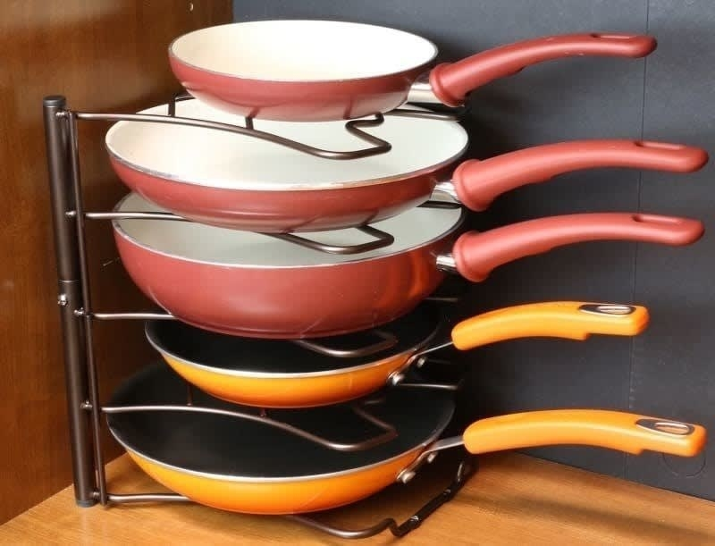 The rack holding various sized pans