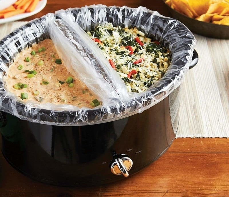 Two liners being used to cook two different things in one slow cooker