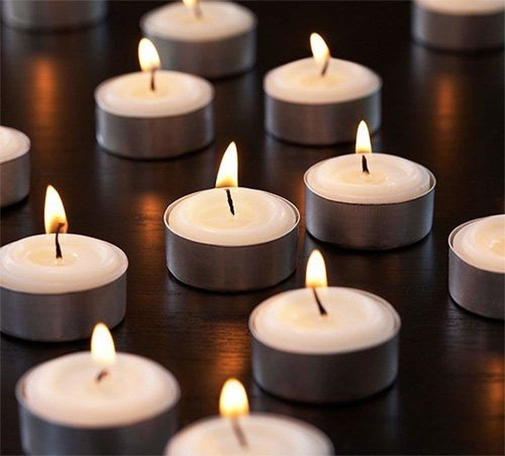 The small, circular tealight candles in small individual pans