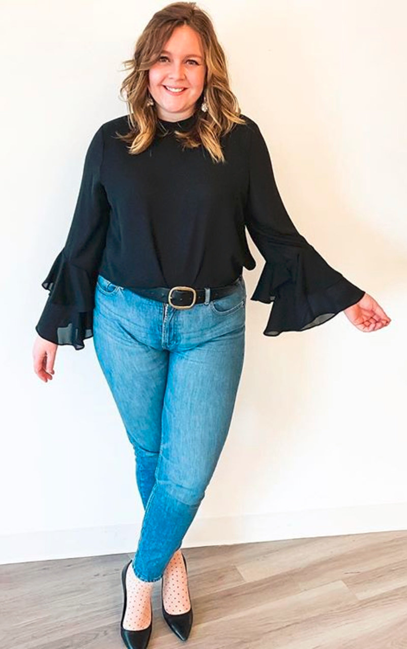 Reviewer in the black bell-sleeve top