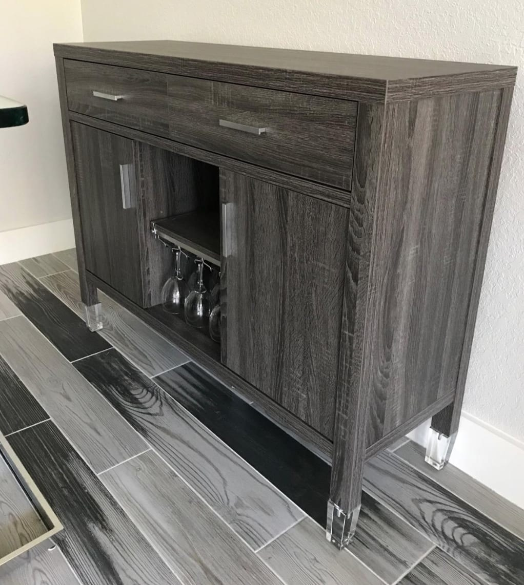 Reviewer image of a gray console with acrylic legs installed