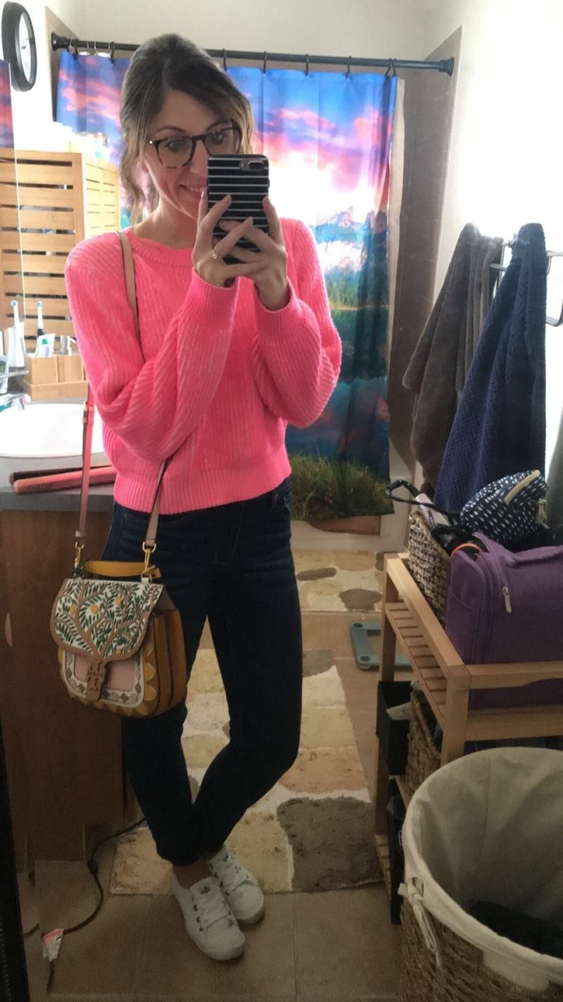 Reviewer in the hot pink cropped sweater