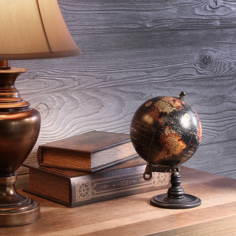 brown globe on a bookshelf