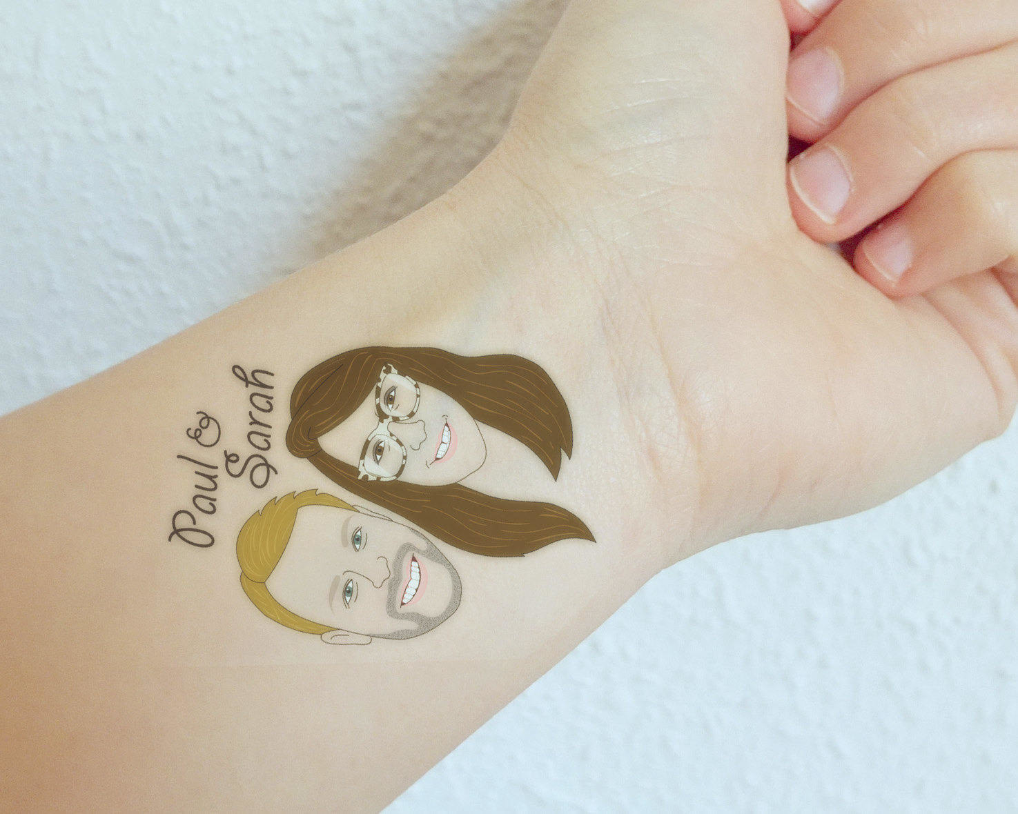 illustrated faces as a temporary tattoo