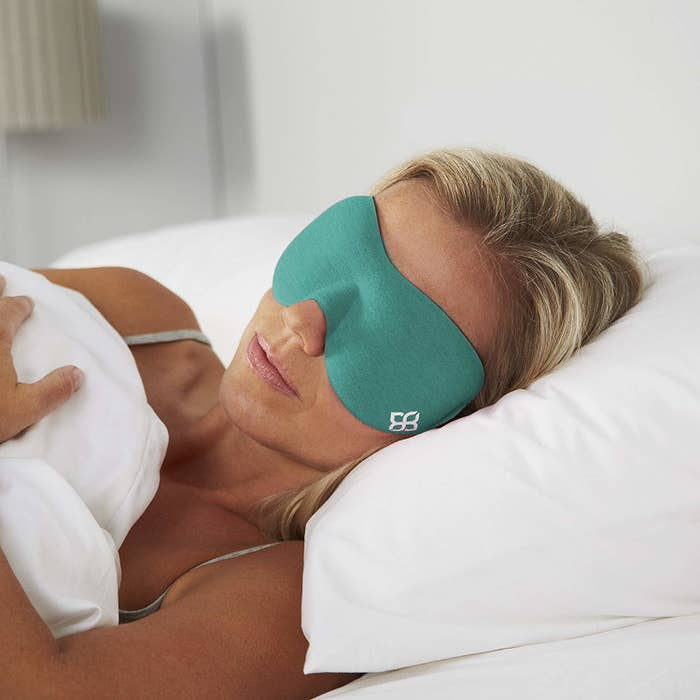 Person sleeping with eye mask on
