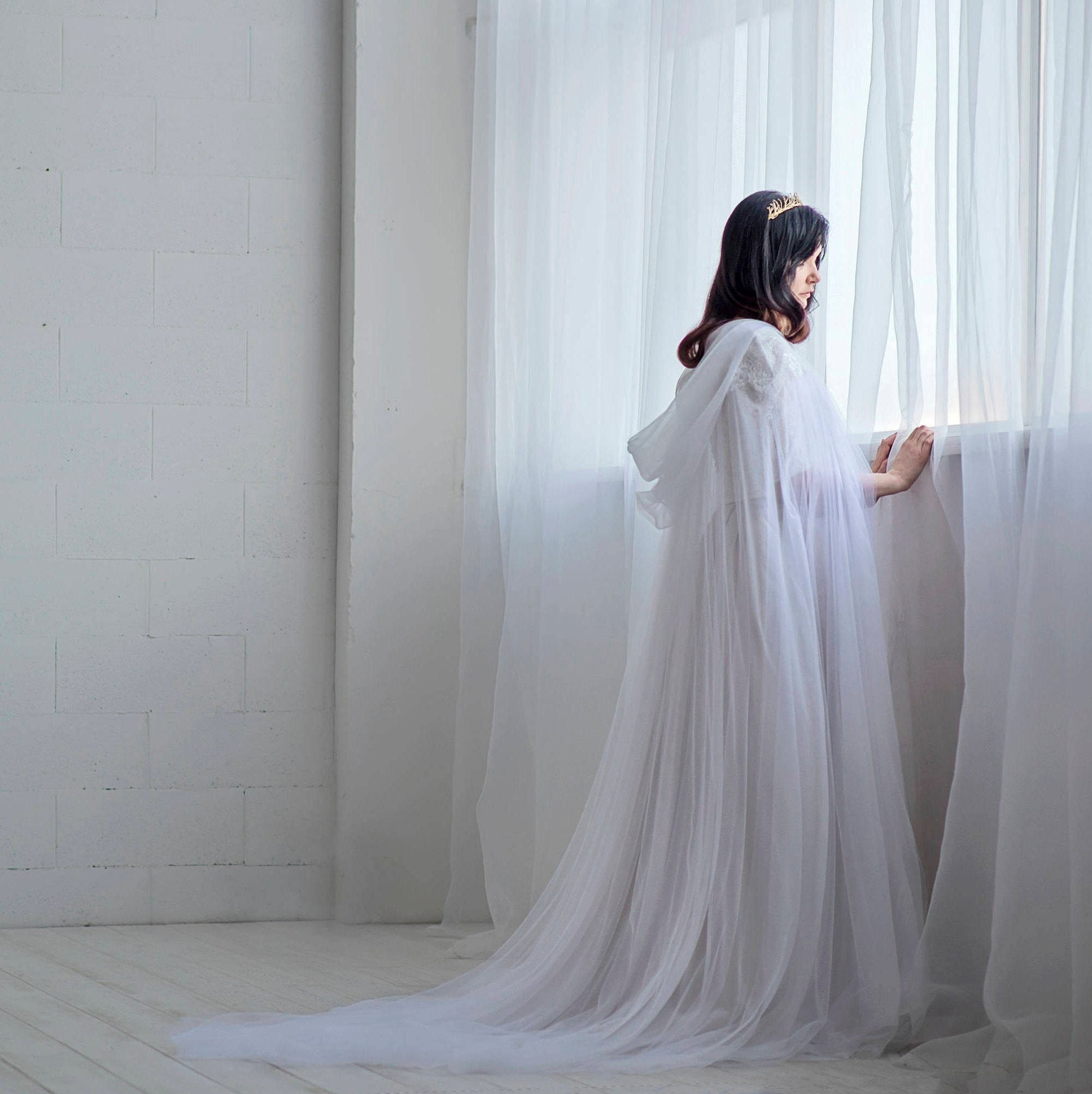 bride in a long tulle cloak