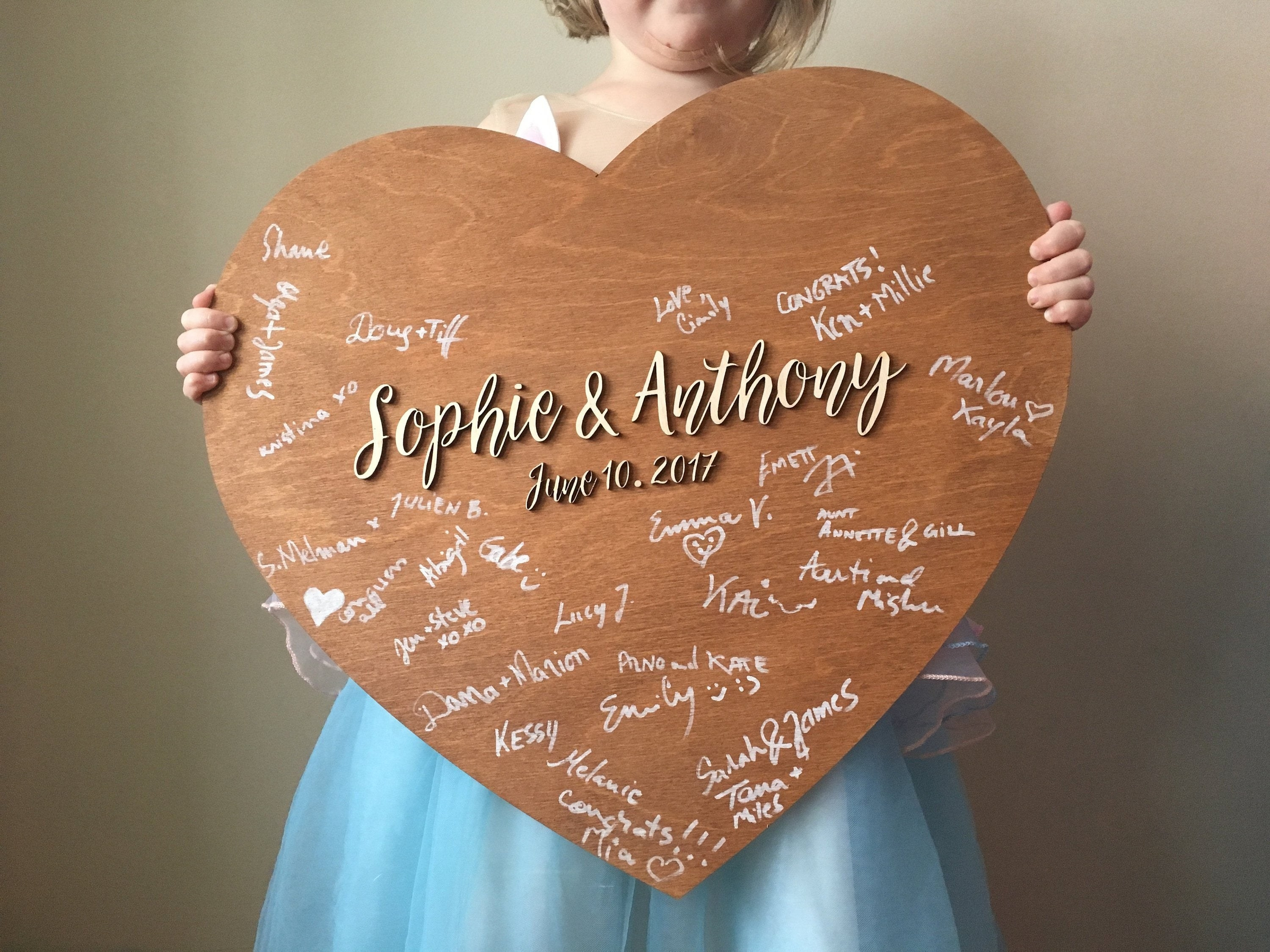 wooden heart that says sophie and anthony