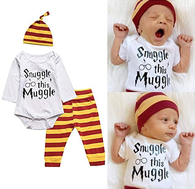 A baby wearing a small hat, long-sleeved bodysuit and pants The bodysuit has Snuggle This Muggle written on it