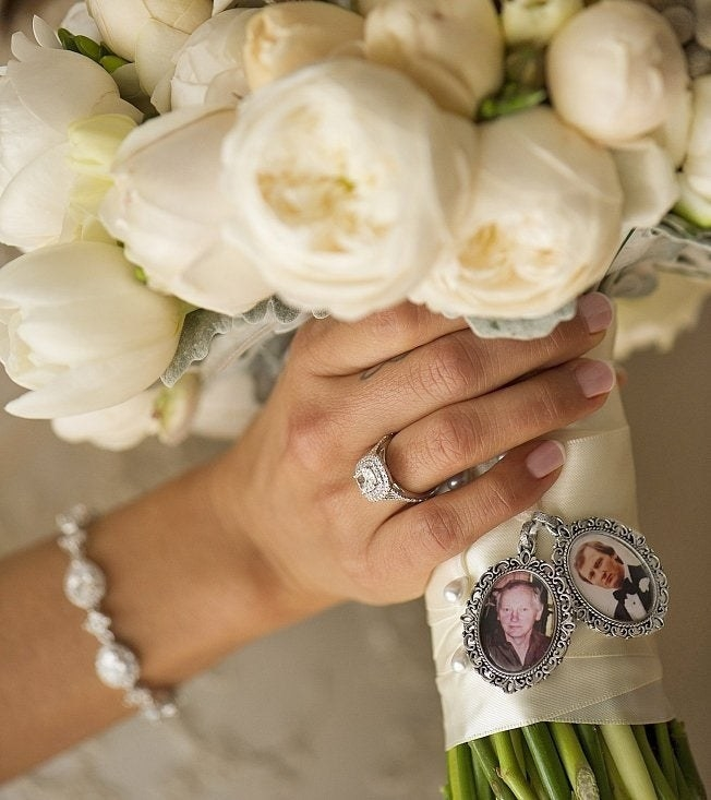 bouquet with two small ornate charms with portraits