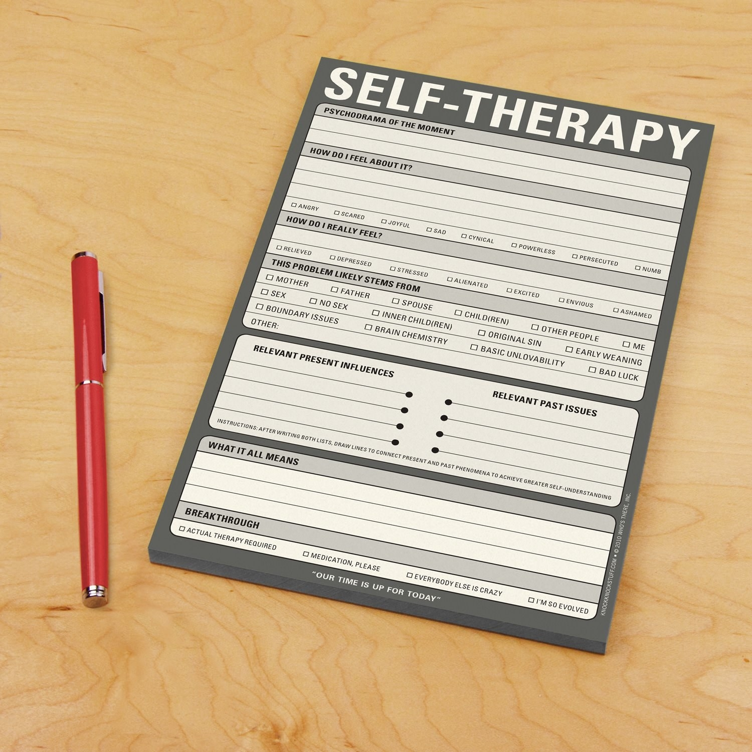 "A grey notepad with the words ""Self-Therapy"" across the top and a number of different questions on it."