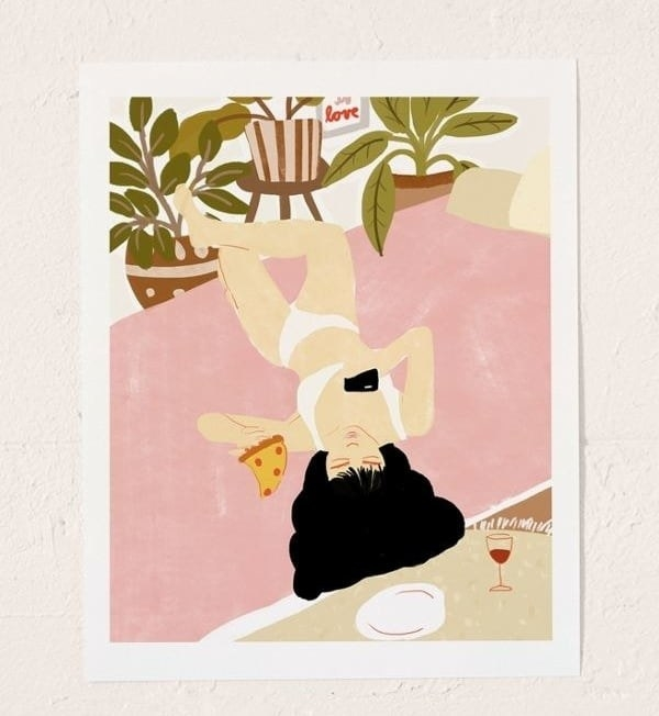 Art print with an illustration of a person in their underwear with a slice of pizza in their hand and a phone in the other, with a glass of wine next to them.