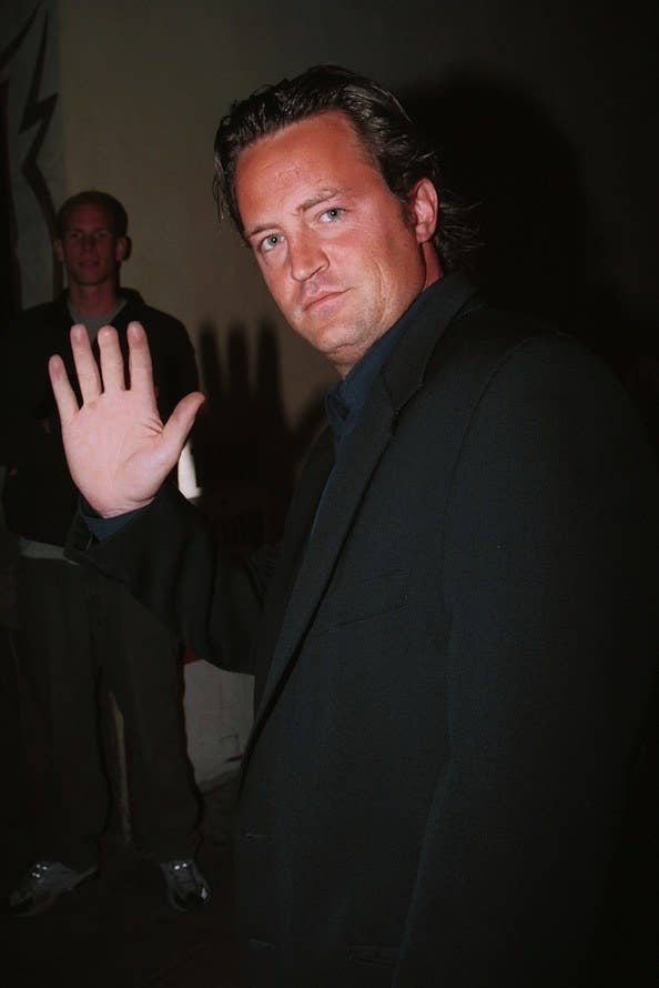 matthew perry showing part of his hand