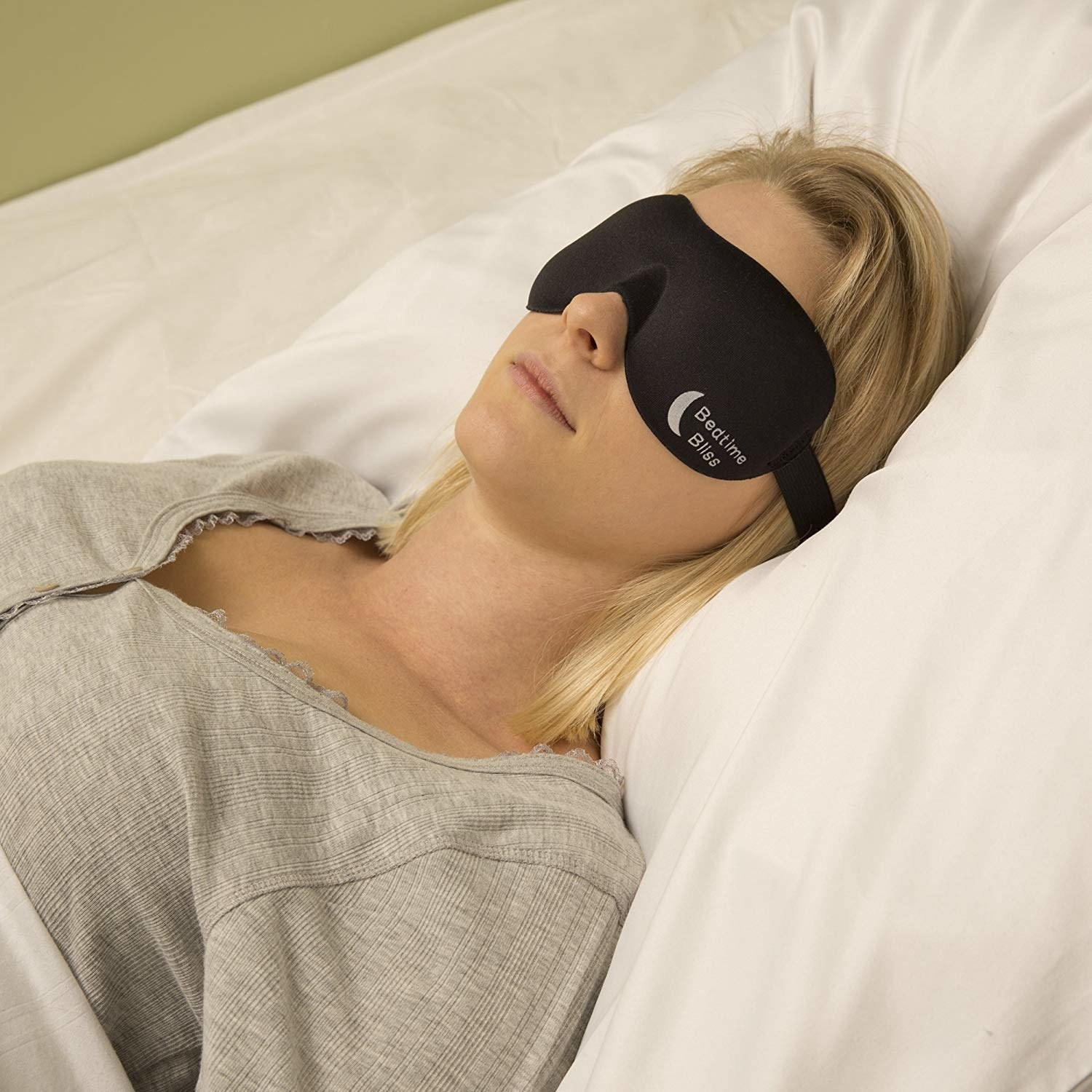 Model wearing the eye mask while in bed